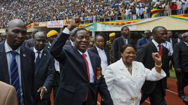 Emmerson Mnangagwa, centre, and his wife Auxillia, centre-right, arrive at the presidential inauguration ceremony in the capital Harare, Zimbabwe on Friday, Nov. 24, 2017. (AP / Ben Curtis)