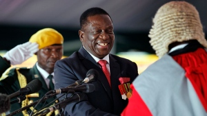 Emmerson Mnangagwa, is sworn in as President at the presidential inauguration ceremony in the capital Harare, Zimbabwe Friday, Nov. 24, 2017. Mnangagwa is being sworn in as Zimbabwe's president after Robert Mugabe resigned on Tuesday, ending his 37-year rule. (AP Photo/Ben Curtis)