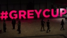 People walk past a Grey Cup sign as they arrive prior to the CFL awards in Ottawa on Nov. 23, 2017. (Nathan Denette / THE CANADIAN PRESS)