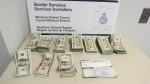 Canadian Border Services Agency officers seized US$26,588 at the Detroit-Windsor Tunnel. (Courtesy CBSA)