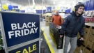 Customers carry a television at Best Buy on Black Friday in Ottawa on November 25, 2016. Chaotic images of people clamouring to be the first through the doors to get their hands on hot deals have become synonymous with Black Friday in recent years. However, the one-day shopping frenzy at malls and stores following American Thanksgiving may be on the decline as some consumers and retailers start to shun the tradition by either opting out entirely or turning to internet shopping instead. (Justin Tang/THE CANADIAN PRESS)