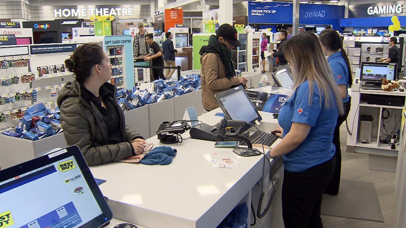 Shoppers are seen at the Best Buy at Metrotown in Burnaby, B.C. on Friday, Nov. 24, 2017.