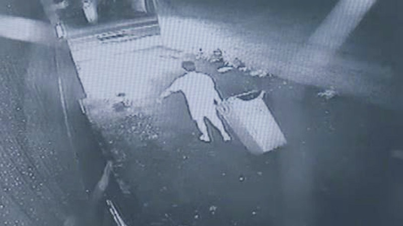 A person is seen dragging a green bin in this still image taken from surveillance video. Exhibits from Christopher Garnier's second-degree murder trial have been released to the media by the Nova Scotia Supreme Court. (Court exhibit)