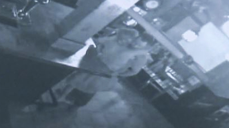 A man and woman are seen embracing in this still image taken from surveillance video inside the Halifax Alehouse. Exhibits from Christopher Garnier's second-degree murder trial have been released to the media by the Nova Scotia Supreme Court. (Court exhibit)