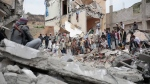 In this Aug. 25, 2017 file photo, people inspect the rubble of houses destroyed by Saudi-led airstrikes in Sanaa, Yemen. (Hani Mohammed/AP Photo)