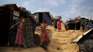 Rohingya children walk to and from tents in Jamtoli refugee camp in Bangladesh on Friday, Nov. 24, 2017. (AP Photo/Wong Maye-E)