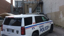 Barrie, Ont. police arrested a man after he climbed onto a Dollararama on Friday, Nov. 24, 2017. (Krista Sharpe/ CTV Barrie)