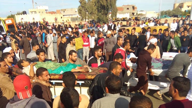 Injured people are evacuated from the scene of a militant attack on a mosque in Bir al-Abd in the northern Sinai Peninsula of Egypt on Friday, Nov. 24, 2017. (AP Photo)