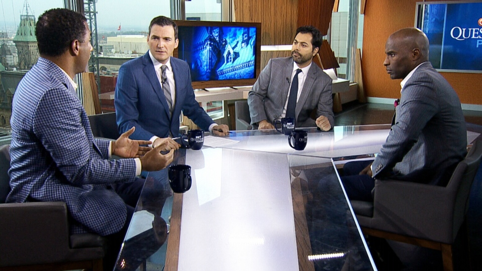 Former CFL players Jock Climie, left, Eric Macramalla, second from right, and Milt Stegall, far right, talk to CTV's Question Period host Evan Solomon.