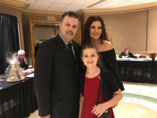 Dino Chiodo, the National Auto Director for Unifor, accepts a community service award with his family. (CTV Windsor / Angelo Aversa)