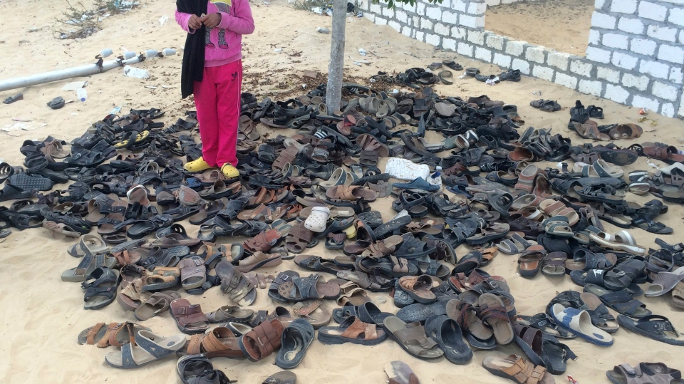 Discarded shoes of victims remain outside Al-Rawda Mosque in Bir al-Abd northern Sinai, Egypt. a day after attackers killed hundreds of worshippers, on Saturday, Nov. 25, 2017. (AP Photo)