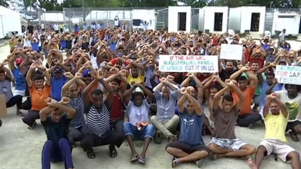 In this file photo made from Australia Broadcasting Corporation video made on Tuesday, Oct. 31, 2017, asylum seekers protesting the possible closure of their detention center, on Manus Island, Papua New Guinea. (Australia Broadcasting Corporation via AP, File)
