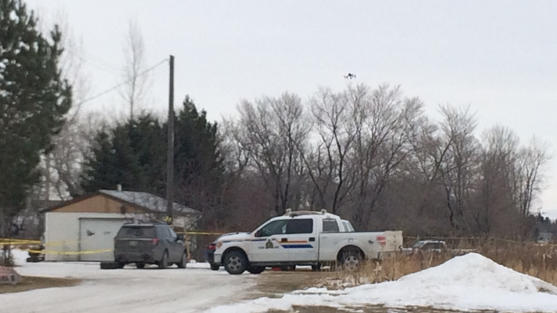 A drone flies above a Neepawa property where RCMP are investigating a man's death as a homicide. (Source: Beth Macdonell/CTV News)