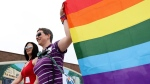 Michelle McHale and Karen Phillips, organizers leading thousands of people who attend the first Pride march in Steinbach, Manitoba, Saturday, July 9, 2016. THE CANADIAN PRESS/Trevor Hagan