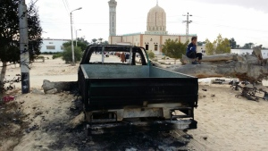 A burned truck is seen outside Al-Rawda Mosque in Bir al-Abd northern Sinai, Egypt a day after attackers killed hundreds of worshippers, on Saturday, Nov. 25, 2017. (AP Photo / Tarek Samy)
