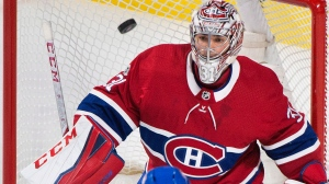 Montreal Canadiens goaltender Carey Price makes a save during first period NHL hockey action against the Buffalo Sabres in Montreal, Saturday, November 25, 2017. THE CANADIAN PRESS/Graham Hughes