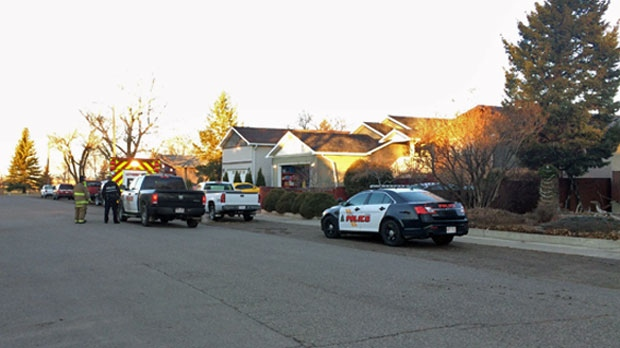 Emergency crews outside of a home in the 1100 block of 43 Ave N in Lethbridge during Sunday morning's armed standoff