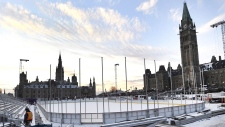 Construction continues on the skating rink on Parliament Hill in Ottawa on Monday, Nov. 20, 2017. THE CANADIAN PRESS/Justin Tang