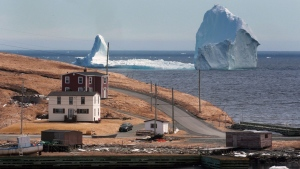 A large iceberg is visible from the shore in Ferryland, an hour south of St. John's, Newfoundland on Monday, April 10, 2017.  THE CANADIAN PRESS/Paul Daly
