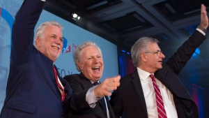 Quebec Premier Philippe Couillard, from the left, former Quebec premier Jean Charest and former Quebec Liberal Party interim leader Jean-Marc Fournier wave to supporters at the 150th anniversary celebrations of the Quebec Liberal Party Saturday, November 25, 2017 in Quebec City. (THE CANADIAN PRESS/Jacques Boissinot)