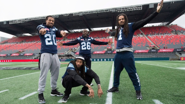 Toronto Argonauts linebacker Rico Murray, from left to right, defensive back Johnny Sears Jr., defensive back Cassius Vaughn and Marcus Ball ham it up for photographers during the final practice in Ottawa on Saturday, November 25, 2017. The Toronto Argonauts will play the Calgary Stampeders in the 105th Grey Cup. THE CANADIAN PRESS / Nathan Denette