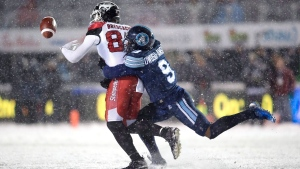 Toronto Argonauts defensive back Akwasi Owusu-Ansah knocks the ball out of the hands of Calgary Stampeders wide receiver Juwan Brescacin during first half CFL football action in the 105th Grey Cup on Sunday, November 26, 2017 in Ottawa. THE CANADIAN PRESS/Nathan Denette