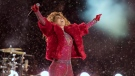 Shania Twain entered a snow-covered TD Place Stadium on a dog sled for her halftime show at the CFL championship game, to the delight of a bundled up crowd of 36,000 football fans.