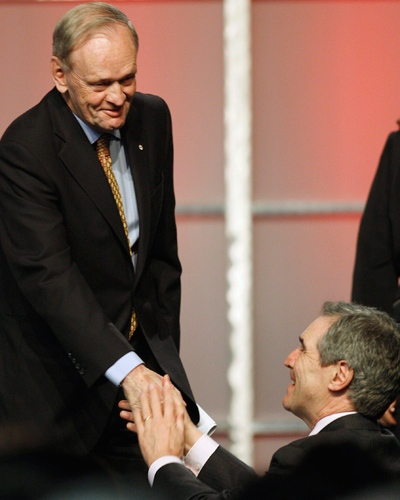 Former prime minister Jean Chretien shakes hands with Liberal Leader Michael Ignatieff following his speech during the official opening ceremonies at the Liberal Leadership Convention in Vancouver, Friday May 1, 2009. (Adrian Wyld / THE CANADIAN PRESS)