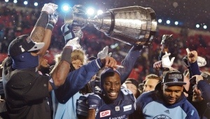 Toronto Argonauts players celebrate with the GreyCup after defeating the Calgary Stampeders in CFL football action in the 105th Grey Cup on Sunday, November 26, 2017 in Ottawa. THE CANADIAN PRESS/Paul Chiasson