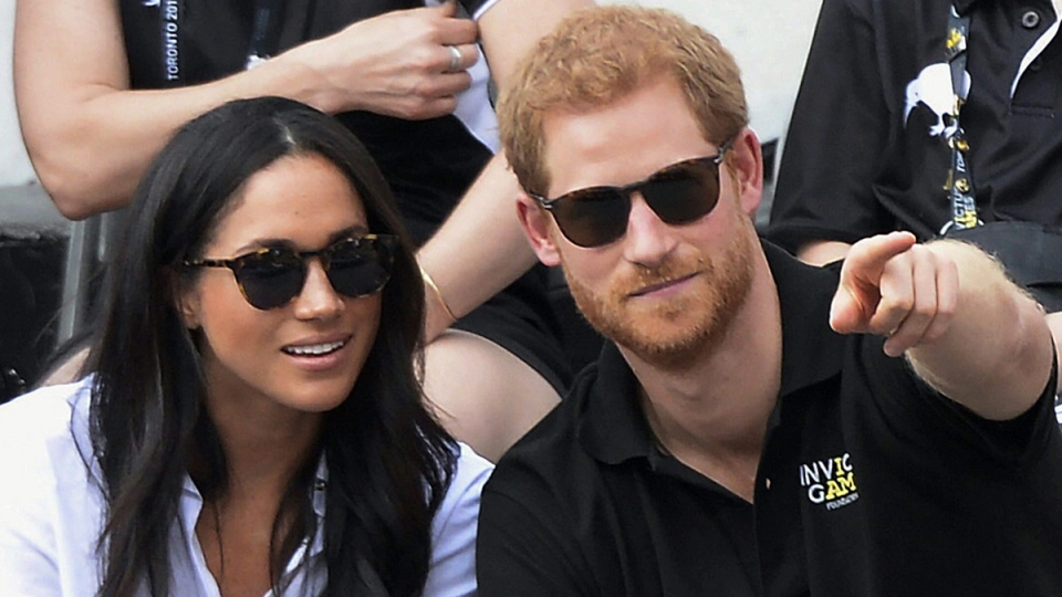 Prince Harry and Meghan Markle attend the Invictus Games in Toronto, on Sept. 25, 2017. (Nathan Denette / The Canadian Press via AP)