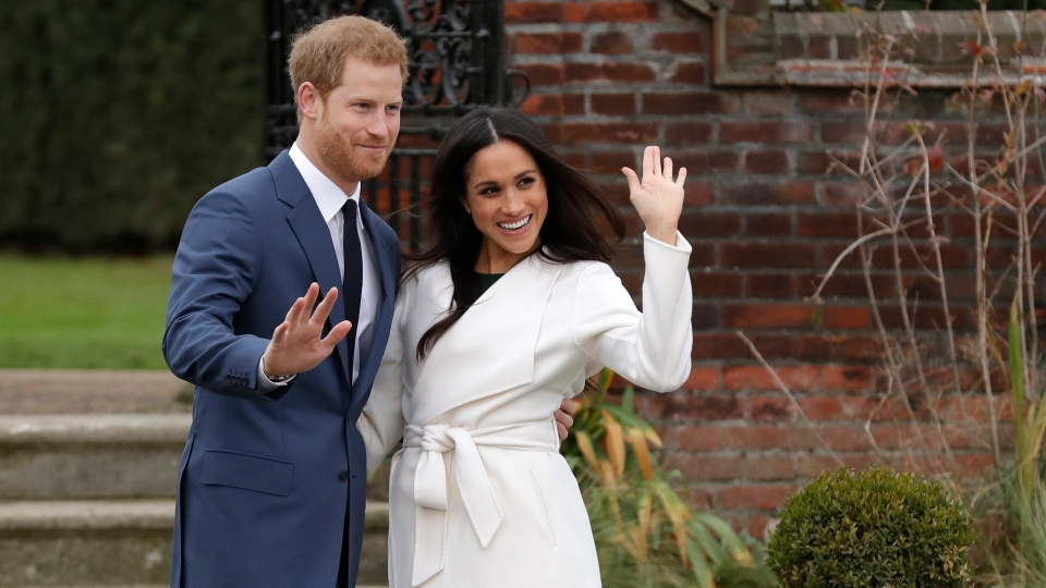 Prince Harry and his fiancee Meghan Markle pose for photographers during a photocall in the grounds of Kensington Palace in London, Monday Nov. 27, 2017. (AP Photo/Matt Dunham)