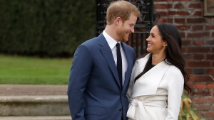 Prince Harry and his fiancée Meghan Markle pose for photographers during a photocall in the grounds of Kensington Palace in London, Monday Nov. 27, 2017. (AP Photo/Matt Dunham)