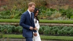 Prince Harry and Meghan Markle arrive for a photocall in the grounds of Kensington Palace in London, Monday Nov. 27, 2017. (AP Photo/Matt Dunham)