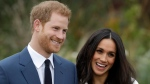 Prince Harry and Meghan Markle pose for photographers during a photocall in the grounds of Kensington Palace in London, Monday Nov. 27, 2017. (AP Photo/Matt Dunham)