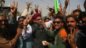 Supporters of the radical religious party, Tehreek-i-Labaik Ya Rasool Allah celebrate after the country's Law Minister Zahid Hamid's resignation, during a sit-in protest in Karachi, Pakistan, Monday, Nov. 27, 2017. (AP / Shakil Adil)