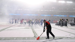 A worker shovels snow prior to the Grey Cup Sunday November 26, 2017 in Ottawa. The Toronto Argonauts will play the Calgary Stampeders in the 105th Grey Cup. (THE CANADIAN PRESS/Paul Chiasson)