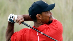 In this Dec. 4, 2016, file photo, Tiger Woods watches his tee shot on the third hole during the final round at the Hero World Challenge golf tournament in Nassau, Bahamas.  (AP Photo/Lynne Sladky)