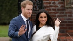 Prince Harry and his fiancee Meghan Markle pose for photographers during a photocall in the grounds of Kensington Palace in London, Monday Nov. 27, 2017. Britain's royal palace says Prince Harry and actress Meghan Markle are engaged and will marry in the spring of 2018. (AP Photo/Matt Dunham)