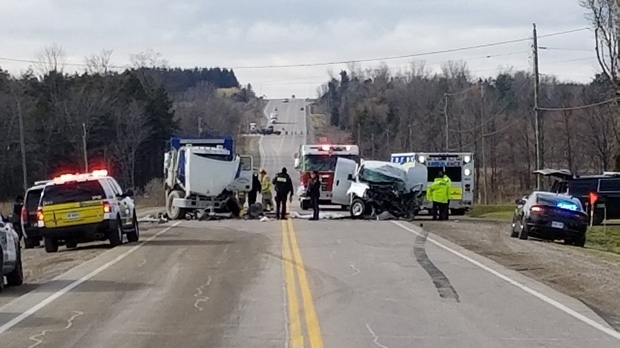 One dead after crash between dump truck, van