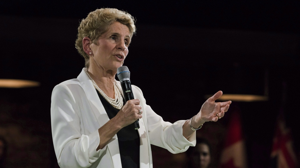 Premier Kathleen Wynne addresses questions from the public during a town hall meeting in Toronto on Monday, November 20, 2017. (THE CANADIAN PRESS/Christopher Katsarov)