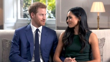 Prince Harry and Meghan Markle speak during their first interview as an engaged couple, Monday, Nov. 27, 2017.