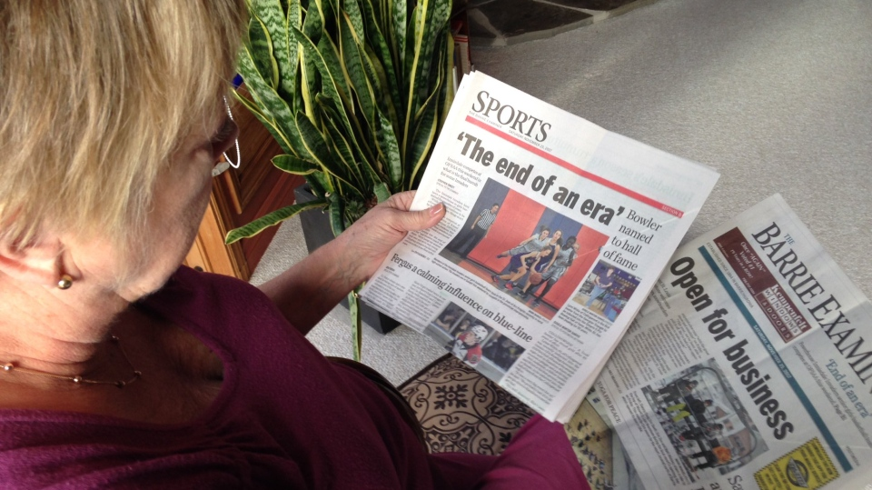Donna Douglas, a former columnist for the Barrie Examiner, holds the last copy of the now shuttered newspaper on Monday, Nov. 27, 2017. (Mike Arsalides/ CTV Barrie)