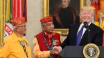 U.S. President Donald Trump, right, meets with Navajo Code Talkers Peter MacDonald, centre, and Thomas Begay, left, in the Oval Office of the White House in Washington, Monday, Nov. 27, 2017. (AP Photo/Susan Walsh)