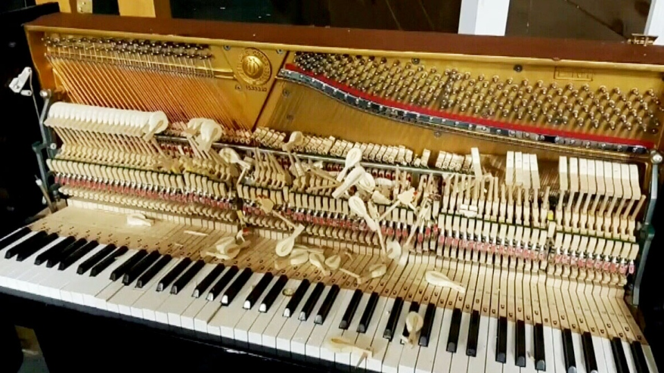 A damaged piano at Church of Christ in St. George, N.B. (Vicki Haddon/Facebook)