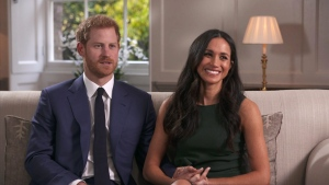 In this photo taken from video Prince Harry and Meghan Markle talk about their engagement during an interview in London, Monday, Nov. 27, 2017. (Pool via AP)