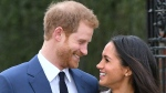 Prince Harry and Meghan Markle pose for the media in the grounds of Kensington Palace in London, Monday Nov. 27, 2017. It was announced Monday that Prince Harry, fifth in line for the British throne, will marry American actress Meghan Markle in the spring, confirming months of rumors. (Eddie Mulholland / Pool / AP)