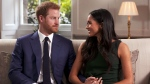 In this photo taken from video Prince Harry and Meghan Markle talk about their engagement during an interview in London, Monday, Nov. 27, 2017. It was announced Monday that Prince Harry, fifth in line for the British throne, will marry American actress Meghan Markle in the spring, confirming months of rumors. (Pool / AP)