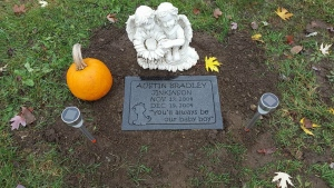 The small, concrete angel was thrown out along with the pumpkin and solar lights.