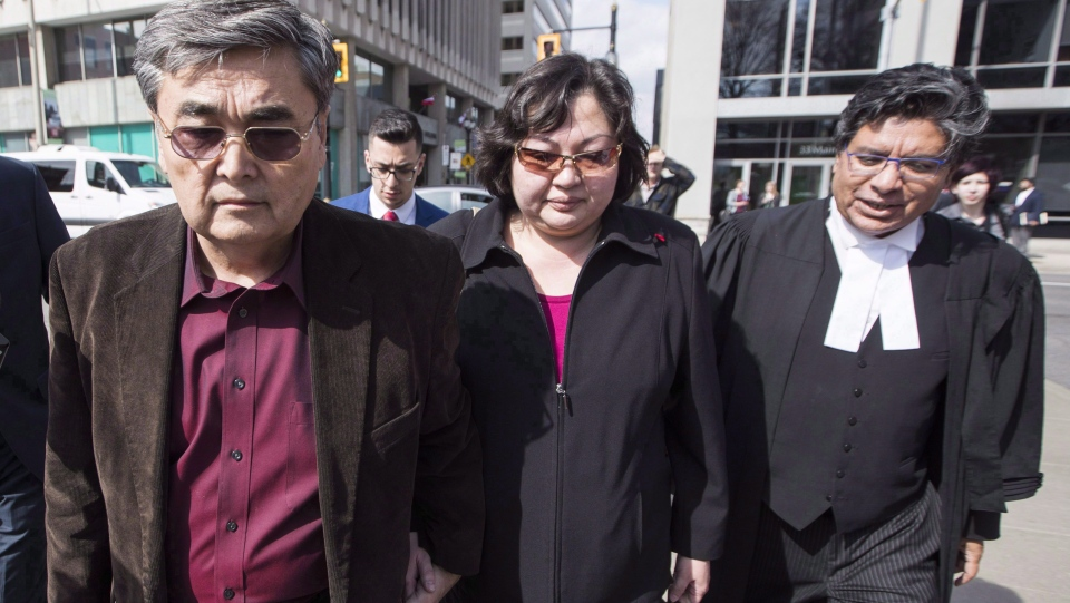 The Canadian man accused in a massive hack of Yahoo emails is set to appear in court today in San Francisco. Akhmet Tokbergenov, left, and Dinara Tokbergenova, parents of alleged Yahoo hacker Karim Baratov, leave the court after their son was denied bail, with lawyer Deepak Paradkar, right, in Hamilton, Ont., on Tuesday, April 11, 2017. (THE CANADIAN PRESS/Mark Blinch)