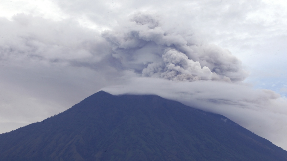 Mount Agung volcano spews smoke and ashes in Karangasem, Bali, Indonesia on Wednesday, Nov. 29, 2017. (AP Photo/Firdia Lisnawati)